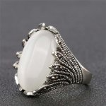 Marked silver ring with mother-of-pearl stone